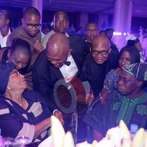 OBJ surrounded by his 'boys' and seated with him is Liberian President, Ellen Johnson Sirleaf